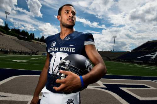 Lennie Mahler  |  The Salt Lake Tribune Utah State quarterback Chuckie Keeton poses for a portrait during media day press availability at Romney Stadium in Logan, Utah, Aug. 4, 2014.