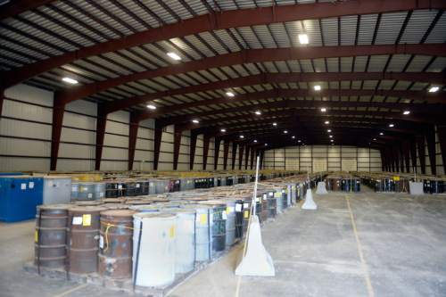 (photo courtesy of David Squires, EnergySolutions) EnergySolutions is temporarily storing barrels of depleted uranium in a controlled warehouse at its Clive facility in Utah's west desert. The Utah Department of Environmental Quality is finalizing its regulation for how this waste will be processed. Eventually, it could be buried in a cell at the complex.