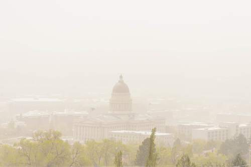 Trent Nelson  |  The Salt Lake Tribune Dust and wind fills the Salt Lake Valley, as seen from the upper Avenues, Tuesday April 14, 2015.