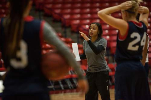 Dixie State Women's Basketball Coach Catherria Turner gives players instruction during a practice at the Burns Arena on Wednesday, November 6, 2013.