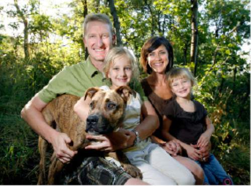 Steve Griffin     Tribune file photo Kirk and Kristen Jowers along a trail above their North Salt Lake home with two of their children Lucy, 6, left, and Emma 4, and their dog Rosie Wednesday Aug. 5, 2008.  Jowers is the director of the Hinckley Institute of Politics at the University of Utah.