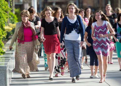 Rick Egan     The Salt Lake Tribune  Women walk to the conference center for the first session of the 185th LDS General Conference, designated as the General Women's Meeting, attended by all LDS females 8-years-old and older, Saturday, March 28, 2015.