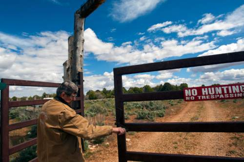 Chris Detrick  |  The Salt Lake Tribune Chris Odekerken opens the gate to his Elkheart Cliff Ranch on Glendale Bench Wednesday May 8, 2013.