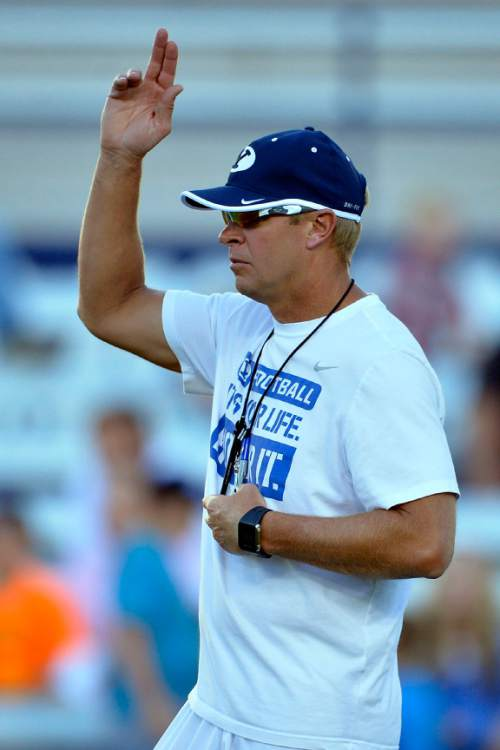 Chris Detrick  |  The Salt Lake Tribune Brigham Young Cougars head coach Bronco Mendenhall during a scrimmage at LaVell Edwards Stadium Friday August 15, 2014.