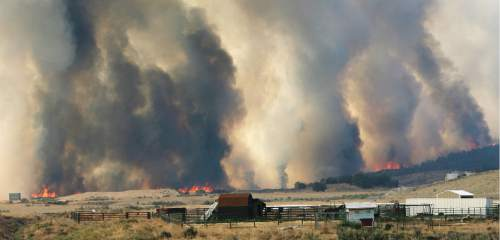 Steve Griffin | The Salt Lake Tribune   A wildfire burns out of control near Camp Williams and Eagle Mountain, Utah Monday August 6, 2012.