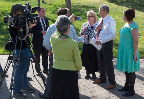 Rick Egan  |  The Salt Lake Tribune  Laura Pennock, Don Braegger and M'lisa D. Martinez talk to the media at City Creek Park about their reasons for opposing the sustaining of the leadership of the LDS Church in the Saturday afternoon session of  LDS General Conference, Saturday, April 4, 2015.