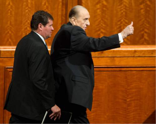 Rick Egan  |  The Salt Lake Tribune  President Thomas S. Monson gives a thumbs-up to the crowd, as he leaves the185th Annual LDS General Conference Priesthood Session, Saturday, April 4, 2015.