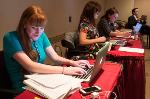 Rick Egan  |  The Salt Lake Tribune  Reporters Sonja Carlson, Ogden Standard-Examiner, and MacKenzie Holbrook, and Lindsey Johnson, of BYU-Idaho, cover the185th Annual LDS General Conference Priesthood Session in the media room, Saturday, April 4, 2015.