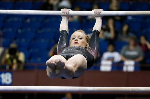 Utah's Georgia Dabritz competes on the uneven parallel bars during the NCAA women's gymnastics championships Sunday, April 19, 2015, in Fort Worth, Texas.  Dabritz won the national title on the event. (AP Photo/Tony Gutierrez)