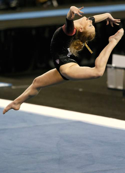 Utah's Georgia Dabritz competes on the floor exercise during the NCAA women's gymnastics championships Sunday, April 19, 2015, in Fort Worth, Texas. (AP Photo/Tony Gutierrez)