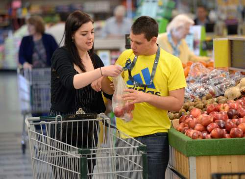 Al Hartmann  |  The Salt Lake Tribune  Jake, a teen from the Carmen B. Pingree Autism Center of Learning, works with teacher's aide Cari Sorensen on a shopping trip to Ream's Food Store in Salt Lake City Tuesday April 14, 2015. The students buy, sort and distribute food items with help of teachers. It's part of a curriculum designed to prepare the students for adulthood.