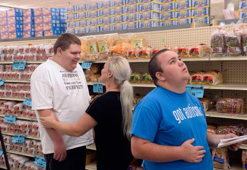 Al Hartmann  |  The Salt Lake Tribune  Teens from the Carmen B. Pingree Autism Center of Learning accompany teacher Markell McCubbin of the adolescent program on a shopping trip to Ream's Food Store in Salt Lake City Tuesday April 14, 2015. Gavynn smiles as McCubbin works with him. The students buy, sort and distribute food items with help of teachers. It's part of a curriculum designed to prepare the students for adulthood.