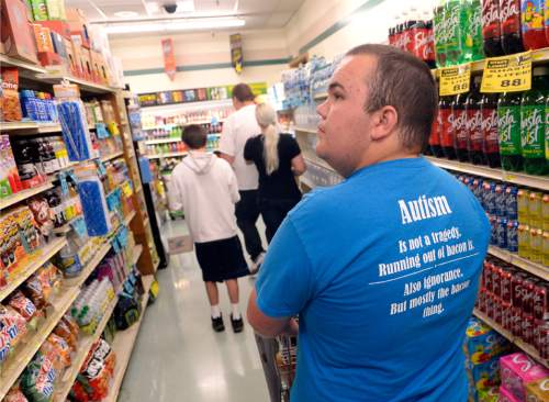 Al Hartmann  |  The Salt Lake Tribune  Teens from the Carmen B. Pingree Autism Center of Learning accompany teachers on a shopping trip to Ream's Food Store in Salt Lake City Tuesday April 14, 2015. Carson Smith, the namesake for a scholarship that serves 700 Utah students with special needs, pushes the cart as teacher Markell McCubbin, Gavynn and Sam go ahead. Students have a shopping list of school needs.  They buy, sort and distribute food items with the help of teachers. It's part of a curriculum designed to prepare the students for adulthood.