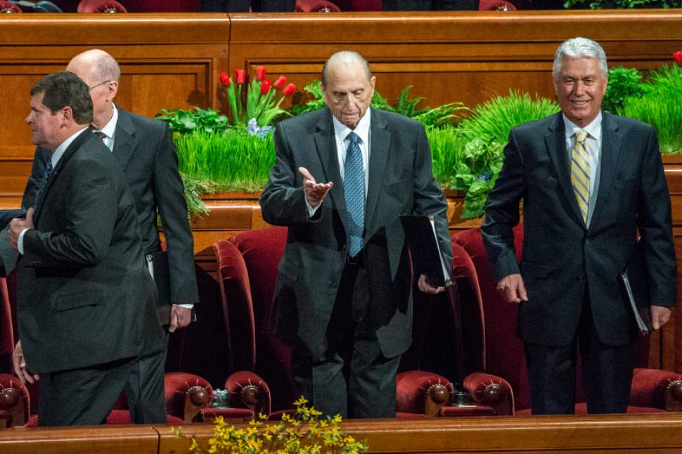 Chris Detrick  |  The Salt Lake Tribune LDS Church President Thomas S. Monson gestures for the crowd to sit during the afternoon session of the 185th Annual LDS General Conference Saturday April 4, 2015.