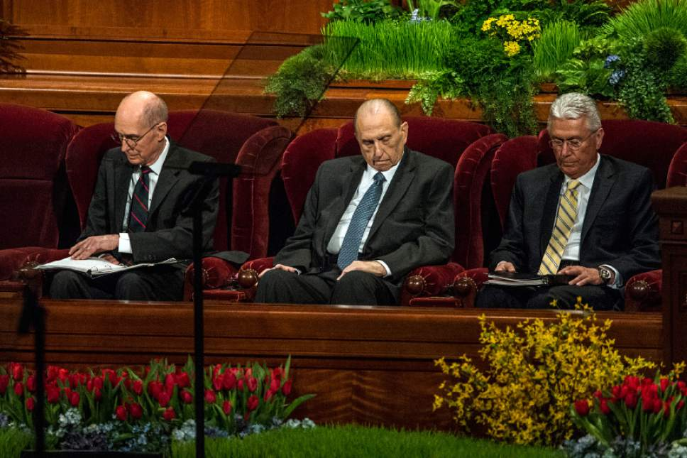 Chris Detrick  |  The Salt Lake Tribune President Henry B. Eyring, first counselor in the First Presidency, Church President Thomas S. Monson and President Dieter F. Uchtdorf, second counselor in the First Presidency, bow their heads as Sister Jean A. Stevens, first counselor in the Primary General Presidency, prays during the afternoon session of the 185th Annual LDS General Conference Saturday April 4, 2015.