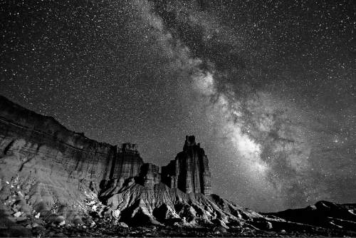 Courtesy  |  Jacob W. Frank, NPS  The Milky Way arches over Capitol Reef National Park's iconic Chimney Rock.