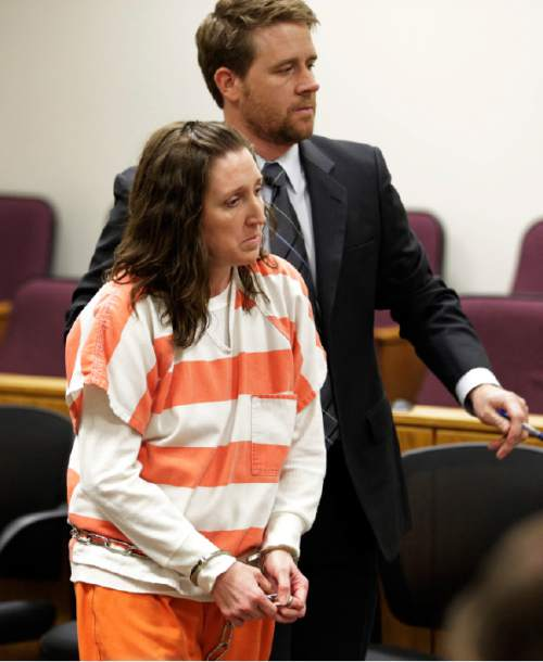 Megan Huntsman arrives in court Monday, April 20, 2015, in Provo, Utah. Huntsman who pleaded guilty to killing six of her newborn babies and hiding their bodies in her garage was sentenced to up to life in prison Monday in a case that drew national attention and sent shockwaves through her quiet community. (AP Photo/Rick Bowmer, Pool)