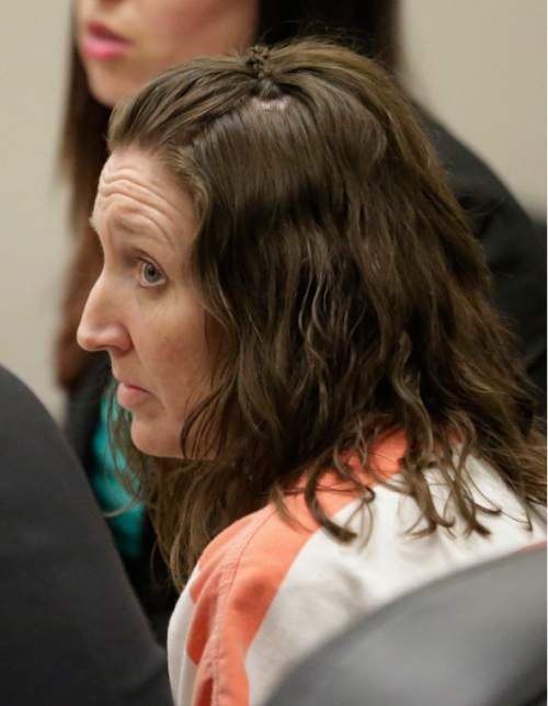 Megan Huntsman looks on during court Monday, April 20, 2015, in Provo, Utah. Huntsman who pleaded guilty to killing six of her newborn babies and hiding their bodies in her garage was sentenced to up to life in prison Monday in a case that drew national attention and sent shockwaves through her quiet community. (AP Photo/Rick Bowmer, Pool)