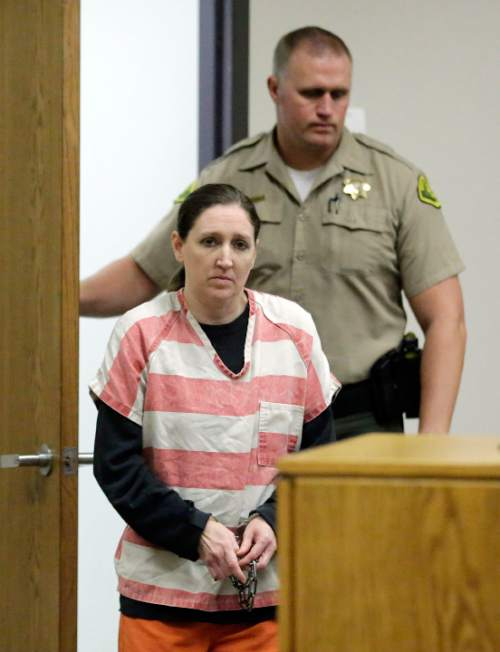 Megan Huntsman, who is accused of killing six of her seven newborns and storing all of their bodies in her garage, appears in court  Monday, Dec. 8, 2014, in Provo, Utah.  Huntsman waived her right to a preliminary hearing. Police say Huntsman, 39, strangled or suffocated the infants from 1996 to 2006, and that a seventh baby found in her garage was stillborn. Investigators say Huntsman was addicted to methamphetamine and didn't want to care for the babies. (AP Photo/Rick Bowmer, Pool)