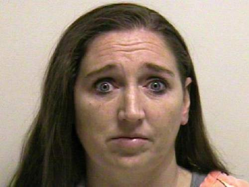 Mugshot of Megan Huntsman, who was booked into the Utah County jail on suspicion of killing six of her newborn children over a 10-year period. Seven dead babies were found on April 12, 2014 in a garage at a Pleasant Grove home where Huntsman lived up until 2011.