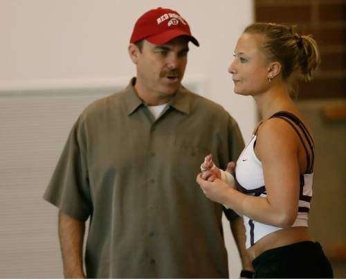 Chris Detrick  |  Tribune file photo Utah gymnastics coach Greg Marsden talks with Nicolle Ford during a practice in 2006.