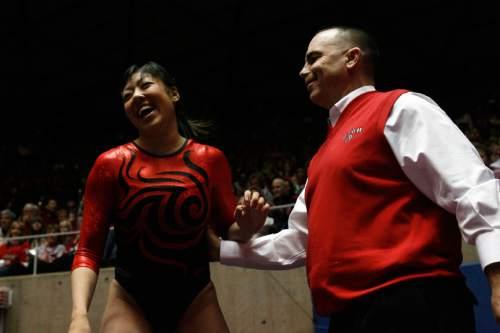 Chris Detrick  |  Tribune file photo  Utah's Nina Kim and coach Greg Marsden celebrate after Kim's vault.