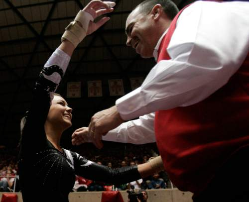 Jim Urquhart  |  Tribune file photo Utah's Kristina Baskett is hugged by her coach Greg Marsden after competing on the vault as University of Utah faced of with Arizona State during college women's gymnastics Friday, March 6, 2009, at the Huntsman Center on the Campus of University of Utah in Salt Lake City.