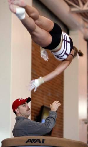 Trent Nelson  |  Tribune file photo Utah gymnastics coach Greg Marsden spots Nicolle Ford on the vault during practice in 2006.