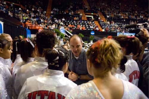 (File photo by Ryan Gardner) Utah coach Greg Marsden gives his team some encouragement after a strong showing on the uneven parallel bars at the NCAA Gymnastics National Championships in Corvallis, Ore., Thursday April 20, 2006.