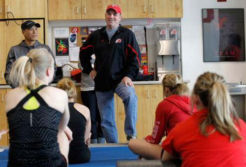 Al Hartmann  |  Tribune file photo Utah gymnasts co-head coach Greg Marsden holds a team meeting before a workout  as they prep for Saturday's NCAA regionals at the Huntsman Center.