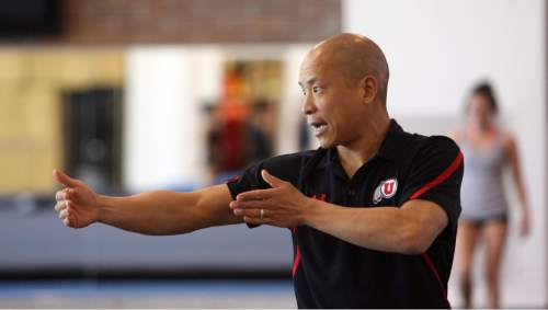 Steve Griffin |  Tribune file photo  University of Utah assistant coach Tom Farden works with gymnasts during practice at the Utah gymnastics practice facility on the campus of the University of Utah in Salt Lake City Friday March 30, 2012.