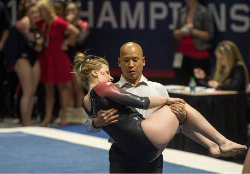 Rick Egan  |  The Salt Lake Tribune  Utah assistant coach Tom Farden carries Tory Wilson off the floor after she was injured early in her floor routine in the Pac-12 Gymnastics Championships at the Huntsman Center, Saturday, March 21, 2015.