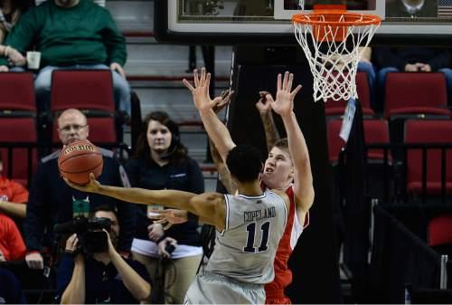 Scott Sommerdorf   |  The Salt Lake Tribune Utah Utes forward Jakob Poeltl (42) defends Georgetown Hoyas forward Isaac Copeland (11) during first half play. Utah and Georgetown were tied 32-32 at the half, Saturday, March 21, 2015.