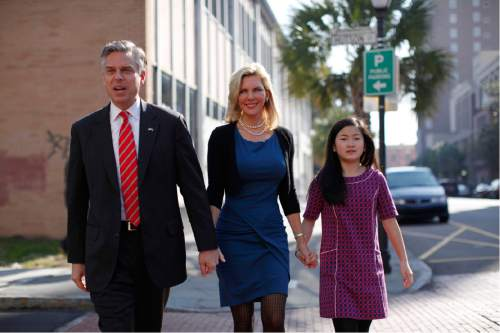 Republican presidential candidate former Utah Gov. Jon Huntsman, his wife Mary Kaye and daughter Gracie, 12, arrive at a campaign stop at Virginia's on King restaurant, Sunday, Jan. 15, 2012, in Charleston, S.C. (AP Photo/Matt Rourke)