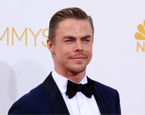 "FILE - In this Aug. 25, 2014 file photo, Derek Hough arrives at the 66th Annual Primetime Emmy Awards at the Nokia Theatre L.A. Live in Los Angeles. Hough is recovering from injuries that have him sitting out of his ""New York Spring Spectacular""show and maybe ""Dancing with the Stars."" The Emmy Award-winning choreographer was injured Monday, April 20, 2015, while rehearsing for next week's 10th Anniversary ""Dancing"" special. He was diagnosed with a broken toe on his right foot and sprains and bone bruising to his left ankle. His publicist confirms 29-year-old Hough will remain in LA this week to rehab his injuries while an understudy is filling in on the Spring Spectacular. (Photo by Jordan Strauss/Invision/AP, File)"
