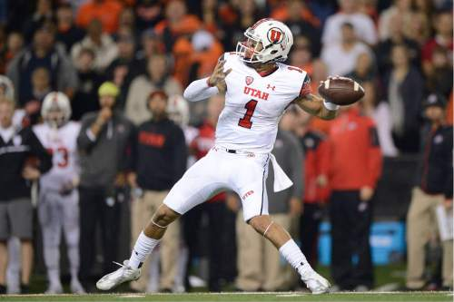 Utah quarterback Kendal Thompson (1) passes during the second quarter against Oregon State in an NCAA college football game in Corvallis, Ore., Thursday, Oct. 16, 2014. (AP Photo/Troy Wayrynen)