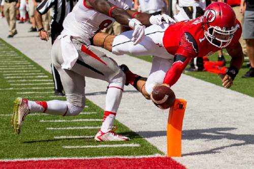 Trent Nelson     The Salt Lake Tribune Utah Utes quarterback Kendal Thompson (1) dives for a touchdown, just ahead of Fresno State Bulldogs defensive back Curtis Riley (9) as Utah hosts Fresno State, college football at Rice-Eccles Stadium Saturday September 6, 2014.