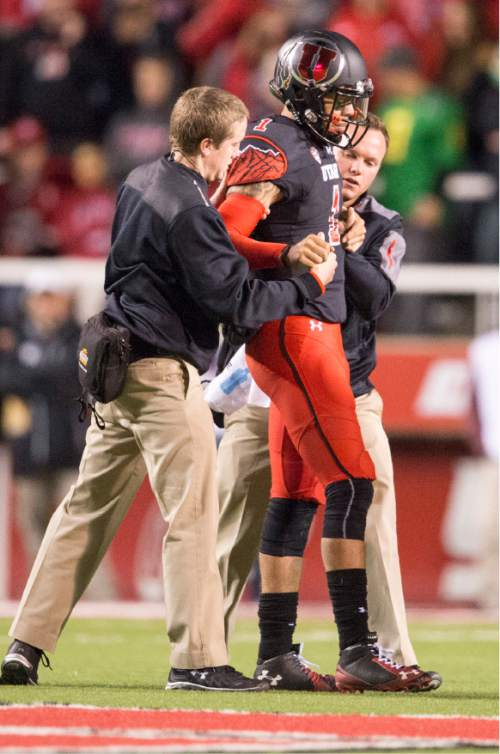 Rick Egan     The Salt Lake Tribune  Utah Utes quarterback Kendal Thompson (1) is helped off the field, in PAC-12 action, Utah vs. Oregon game, at Rice-Eccles Stadium, Saturday, November 8, 2014
