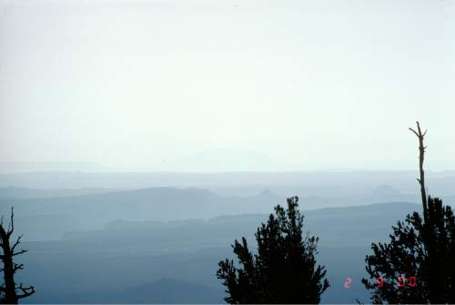 Courtesy  |  Colorado State University  These photos show a hazy day and a clear day in Bryce Canyon National Park. The photos, taken between 1984 and 1996, are maintained by Colorado State University for regional haze monitoring.