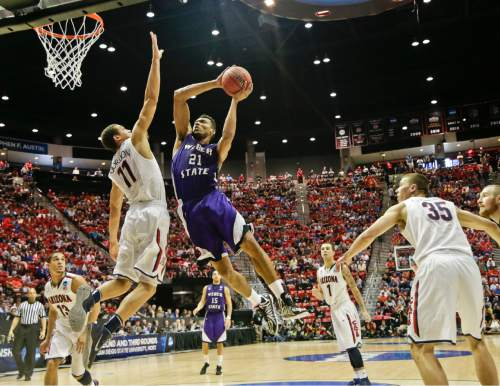 Weber State's Joel Bolomboy (21) tries ot shoot over Arizona forward Aaron Gordon during the second half in a second-round game in the NCAA college basketball tournament Friday, March 21, 2014, in San Diego. (AP Photo/Gregory Bull)