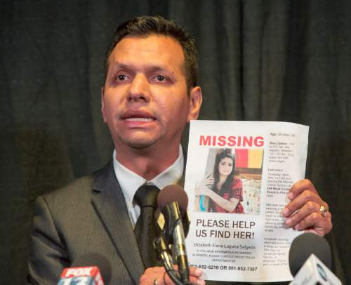 Rick Egan  |  The Salt Lake Tribune  Rosemberg Salgado holds a picture of his niece, as he pleads for help in the search for missing Provo woman, 26-year-old, Elizabeth Elena Laguna-Salgado, who was last seen April 16. Friday, April 24, 2015.