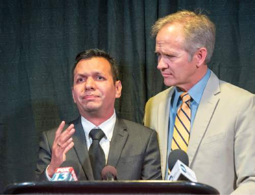 Rick Egan  |  The Salt Lake Tribune  Rosemberg Salgado stands next to Ed Smart at a press conference, as he pleads for help in the search for missing Provo woman, 26-year-old, Elizabeth Elena Laguna-Salgado, who was last seen April 16. Friday, April 24, 2015. Salgado is Elena's uncle.
