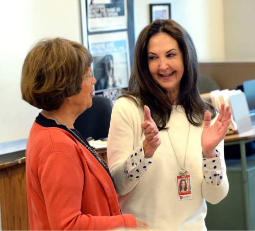Al Hartmann  The Salt Lake Tribune Leigh M. VandenAkker, a Techniques for Tough Times/social studies teacher at Salt Lake City's East High School, right, is surprised Monday April 27, 2015, by Karen Huntsman suddenly appearing in her classroom with a $10,000 gift. She is the first of 11 Huntsman Education Award winners for 2015.