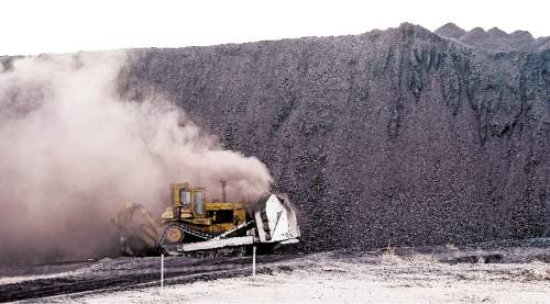 Francisco Kjolseth     The Salt Lake Tribune  Crews move coal at the Levan transfer facility along Interstate 15 south of Nephi where a steady flow of trucks unload it before it is transferred to train cars. Utah's Community Impact Board has awarded a $53 million loan to four coal-producing counties to invest in a deep-water port in Oakland, Calif. hoping to connect central Utah commodities with export markets. Bowie Resource Partners already exports about 1 to 3 million tons of coal from its Utah mines.