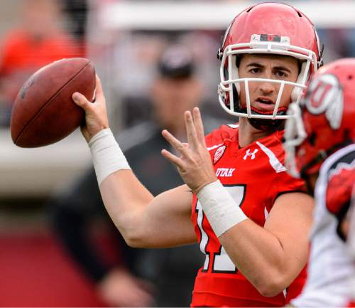 Trent Nelson  |  The Salt Lake Tribune Quarterback Conner Manning looks to pass at the Utah Football Red & White game in Salt Lake City, Saturday April 25, 2015.