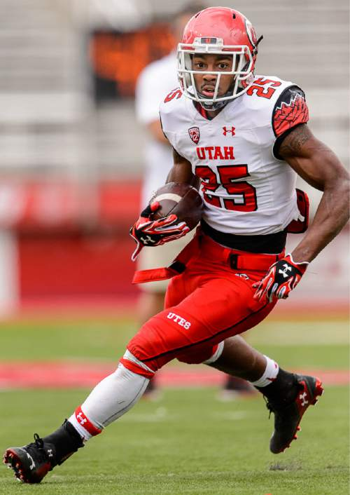 Trent Nelson  |  The Salt Lake Tribune Monte Seabrook runs the ball at the Utah Football Red & White game in Salt Lake City, Saturday April 25, 2015.