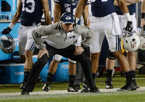 Steve Griffin  |  The Salt Lake Tribune   BYU head coach Bronco Mendenhall squats down as he watches his defense come up big stopping a Houston drive late in the second half of the game between BYU and Houston and LaVell Edwards Stadium in Provo, Thursday, September 11, 2014.