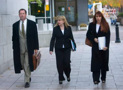 Al Hartmann  |  The Salt Lake Tribune Brian David Mitchell's Defense team of Parker Douglas, left Wendy Lewis, and Audrey James walk to the Frank E. Moss Federal Courthouse for the start of jury selection Monday November 1st.