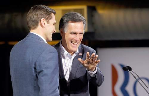 AP File Photo Republican presidential candidate former Massachusetts Gov. Mitt Romney waves on stage with his son Josh, left, at his Colorado caucus night rally in Denver, Tuesday, Feb. 7, 2012. (AP Photo/Gerald Herbert)
