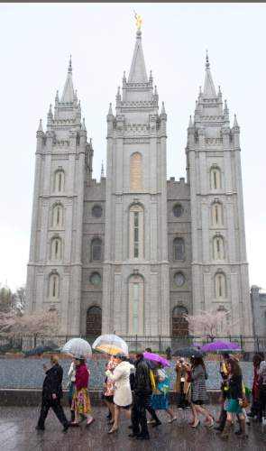 Steve Griffin     The Salt Lake Tribune   Members and supporters of the Ordain Women walk in front of the Temple on their way to the Tabernacle on Temple Square to seek standby tickets to the all-male general priesthood meeting in Salt Lake City, Utah Saturday, April 5, 2014.